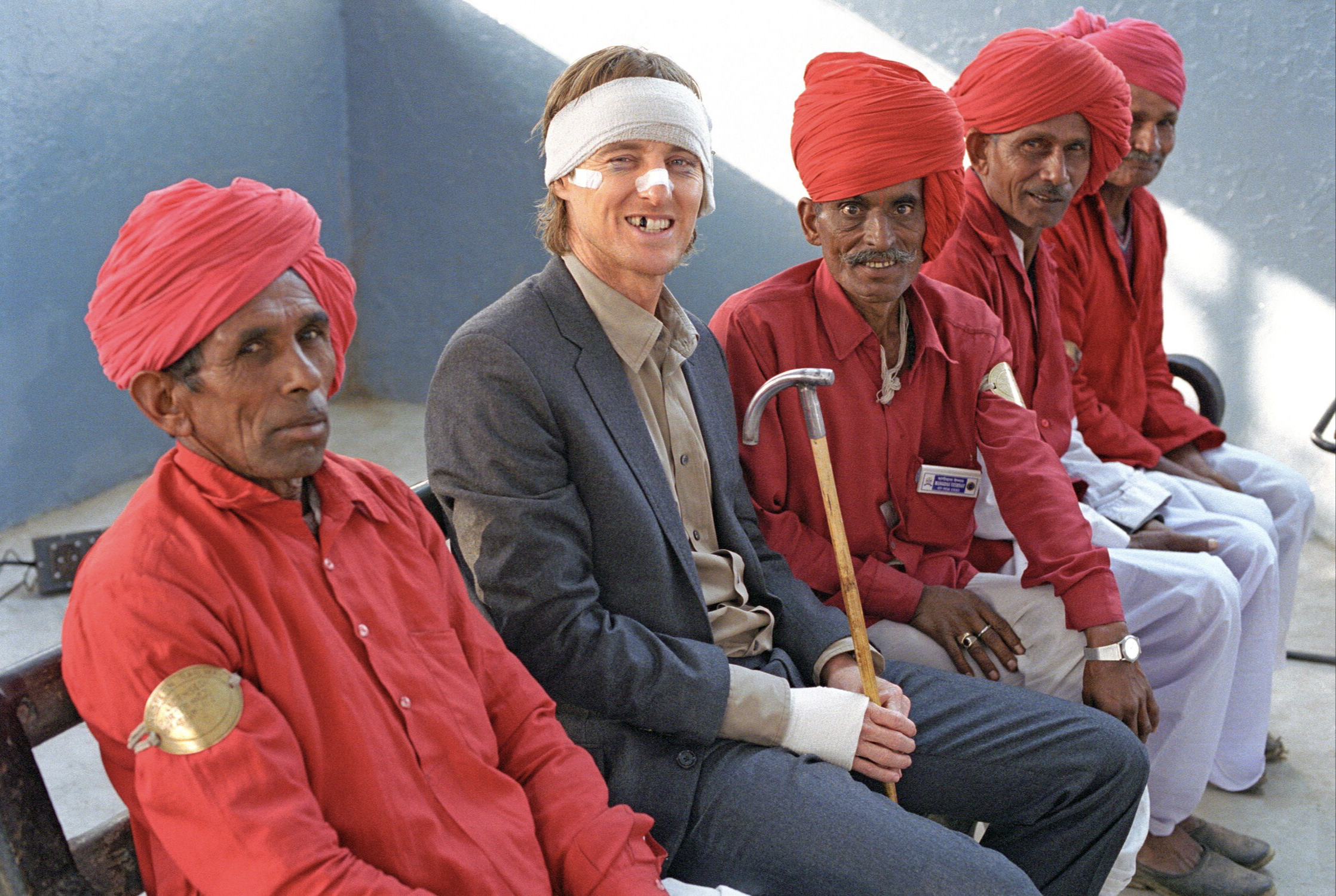 Owen Wilson and extras waiting for a train Rajasthan, India, 2007