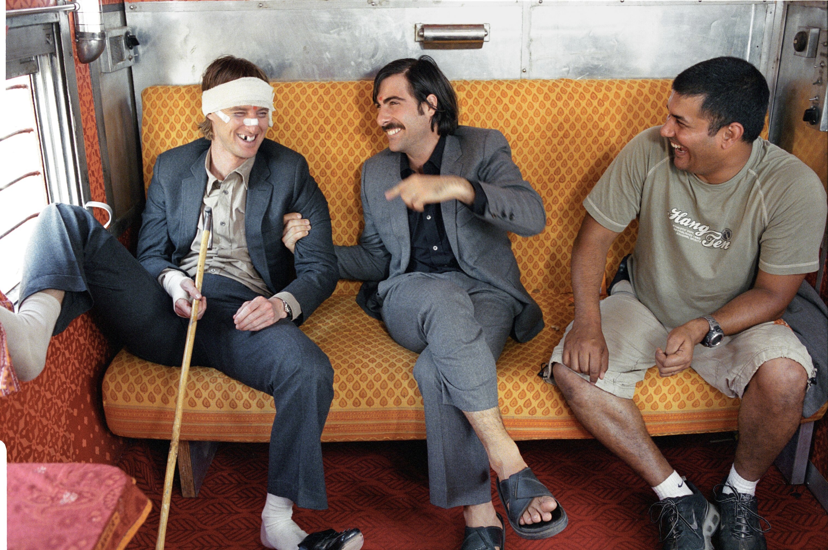 Owen Wilson and Jason Schwartzman joking on the set with cameraman, Sami Songay, Rajasthan, India, 2007